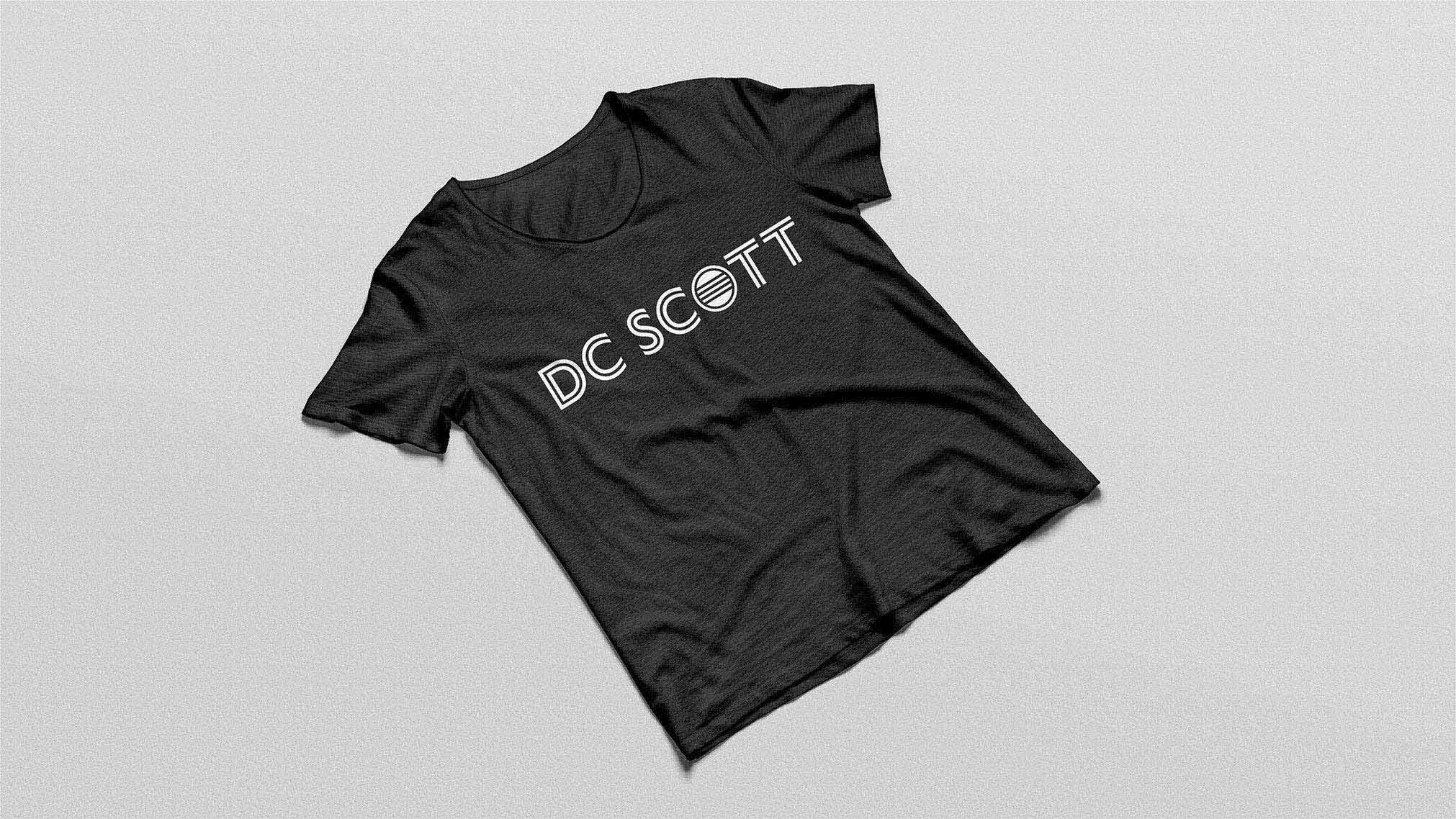 DC Scott, a local musician wanted to highlight their name and a guitar element in their brand. Using a stylized O to represent the guitar sound hole I made sure that the lines in the graphic element matched the lines through the other letters.